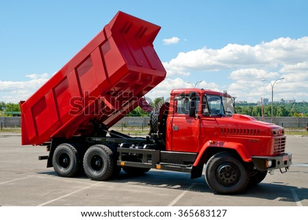 Kiev, Ukraine - May 26,  2009.. Red dump truck with the body lifted for unloading.