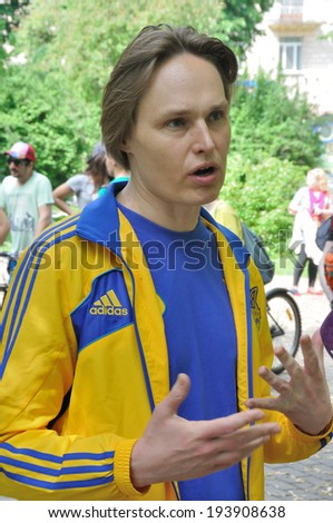"""KIEV, UKRAINE - 17 MAY 2014: The General Manager of Ukrainian National sport complex """"Olimpiyskiy"""" and politic Sergiy Simak meets with fan on May 17, 2014 in Kiev, Ukraine  - stock photo"""