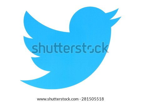 KIEV, UKRAINE - MAY 26, 2015:Twitter logotype bird printed on paper. Twitter is an online social networking service that enables users to send and read short messages. - stock photo