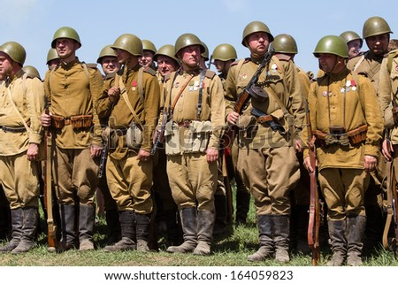KIEV, UKRAINE - MAY 11 : Unidentified members of Red Star history club wear historical Soviet uniform during historical reenactment of WWII on May 11, 2013 in Kiev, Ukraine