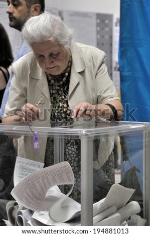 KIEV, UKRAINE � 25 MAY 2014: Unknown people vote on the president and local election on 25 May 2014 in Kiev, Ukraine.