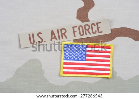 KIEV, UKRAINE - May 9, 2015. US AIR FORCE branch tape on desert camouflage uniform background