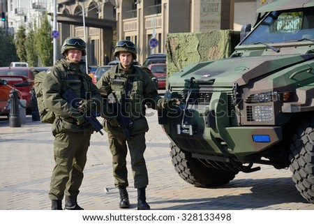 Kiev, Ukraine,  Michael's Square, October 16, 2015. The exhibition of military equipment, on the Day of Defender of Ukraine. Soldiers of the National Guard exhibit military equipment. - stock photo