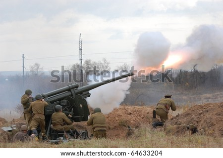 KIEV, UKRAINE - NOV 7: A members of military history club wears historical Soviet uniform & air defense cannon during historical reenactment of WWII,November 7, 2010 in Kiev, Ukraine - stock photo