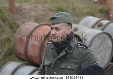 KIEV, UKRAINE -NOV 2  An unidentified member of Red Star history club wears historical German uniform during historical reenactment of WWII, Battle for Kiev 1943 on November 2, 2013 in Kiev, Ukraine