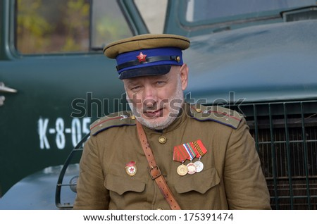 KIEV, UKRAINE -NOV 2: An unidentified member of Red Star history club wears historical Soviet uniform during historical reenactment of WWII, Dnepr river crossing 1943, November 2, 2013 Kiev, Ukraine  - stock photo
