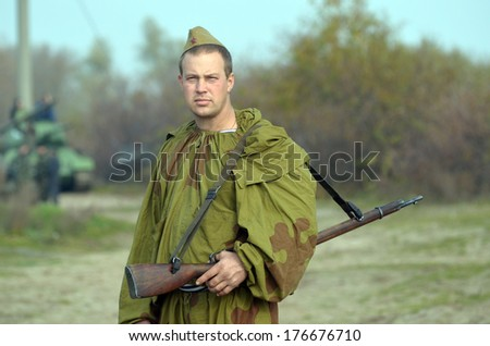 KIEV, UKRAINE -NOV 3: An unidentified member of Red Star history club wears historical Soviet uniform during historical reenactment of WWII, Dnepr river crossing 1943, November 3, 2013 Kiev, Ukraine  - stock photo