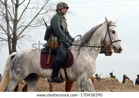 KIEV, UKRAINE -NOV 3 An unidentified members of Red Star history club wear historical German uniform during historical reenactment of WWII, Dnepr river crossing 1943, November 3, 2013 Kiev, Ukraine