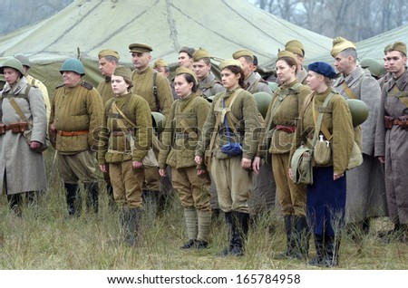 KIEV, UKRAINE -NOV 3. An unidentified members of Red Star history club wear historical Soviet uniform during historical reenactment of WWII, Dnepr river crossing 1943, November 3, 2013 Kiev, Ukraine  - stock photo