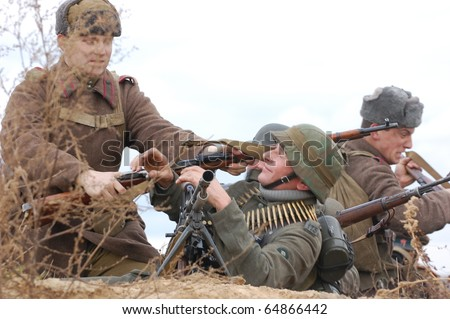 KIEV, UKRAINE - NOV 7: members of Red Star history club wear historical German&Soviet uniform during historical reenactment of Kiev Liberation in 1943, November 7, 2010 in Kiev, Ukraine