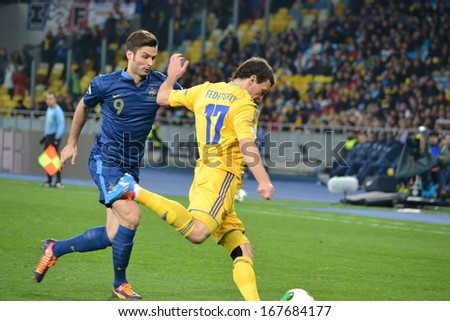 KIEV, UKRAINE - NOV 15: Olivier Giroud (L) against Fedetskiy (R) during the play-off match for the 2014 World Cup between Ukraine vs France, 15 November 2013, NSC Olympic Stadium, Kiev, Ukraine