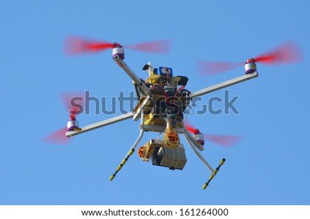 KIEV, UKRAINE -NOV 3: Quadrocopter drone flies with mounted  digital camera  during historical reenactment of WWII, Dnepr river crossing 1943, November 3, 2013 . Kiev, Ukraine