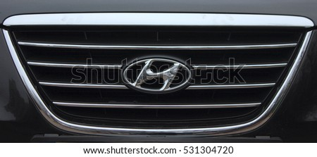 KIEV, UKRAINE - NOVEMBER 24, 2016: Front view of black Hyundai Sonata car. Hyundai is a famous worldwide car company.