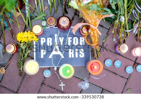 KIEV, UKRAINE - November 15, 2015: people brought flowers to the Embassy of France. mourning  for the victims of terrorist attacks  in Paris 13.11.2015 - stock photo