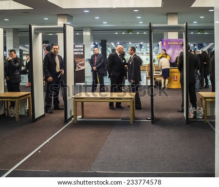 KIEV, UKRAINE - November 27, 2014:Security guard at the entrance to the hall almost no work. Ukrainian ultranationalists tried to disrupt the concert of popular singer Ani Lorak.  - stock photo