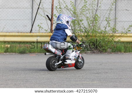 Kiev, Ukraine - Now 22: A child is riding a motorcycle. Extreme riding, on Now 22, 2015 in Kiev, Ukraine