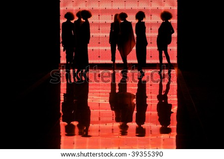 "KIEV, UKRAINE - OCT 15: Silhouette of models on the runway during Fashion Show by ""GROMOVA DESIGN"" as part of Ukrainian Fashion Week, October 15, 2009 in Kiev, Ukraine."