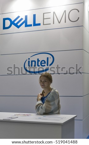 KIEV, UKRAINE - OCTOBER 09, 2016: Beautiful girl presenter works on Dell Emc, American data storage company booth during CEE 2016, the largest electronics trade show of Ukraine in KyivExpoPlaza EC.