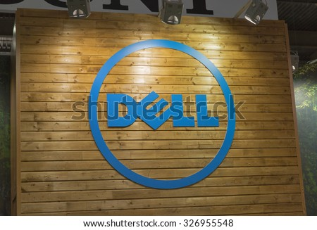 KIEV, UKRAINE - OCTOBER 11, 2015:  Dell logo on a wooden base illuminated by searchlights on company booth during CEE 2015, largest electronics trade show of Ukraine in ExpoPlaza Exhibition Center.