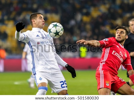 KIEV, UKRAINE: October 19, 2016: Derlis Gonzales (L) of Dynamo Kyiv in fight the ball with NEduardo Salvio of SL Benfica during UEFA Champions League game at NSC Olimpiyskiy Stadium
