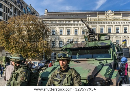 "KIEV, UKRAINE - OCTOBER 14, 2015: Exhibition ""Power of Unbroken"" on Mykhailivska Square on Day of Defender of Ukraine. Soldiers of the National Guard exhibit military equipment."