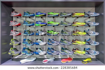 KIEV, UKRAINE - OCTOBER 26 2014: Exposition of New Balance and Saucony sport shoes. They are one of the world's largest suppliers of athletic shoes and apparel. October 26, 2014 in Kiev Ukraine - stock photo