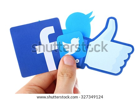 KIEV, UKRAINE - OCTOBER 12, 2015. Facebook, twitter in hand. Hand holding popular social media icons - stock photo