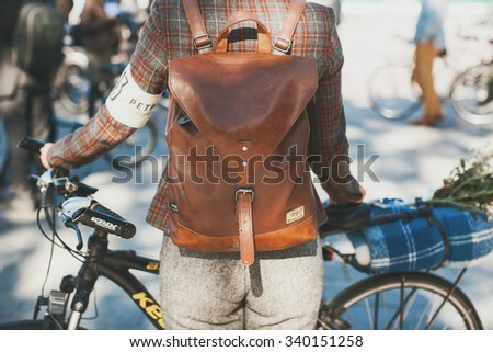KIEV, UKRAINE - OCTOBER 4: People in tweed vintage clothing participating in bicycle Retro cruise on October 4, 2015 in Kiev, Ukraine in botanic garden