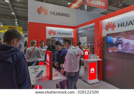 KIEV, UKRAINE - OCTOBER 11, 2015: People visit Huawei, Chinese  electronics manufacturer company booth during CEE 2015, the largest electronics trade show of Ukraine in ExpoPlaza Exhibition Center - stock photo