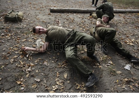 "KIEV,UKRAINE - October 2, 2016: Recruits regiment ""Azov"" during the final exam ""the Spartan Azov"" in the selection camp in Kiev."