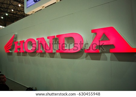 Kiev,Ukraine-17 of March,2013.Logo Honda,Honda logotype,Honda international industrial company for the production of cars and motorcycles.Detail of Honda stand