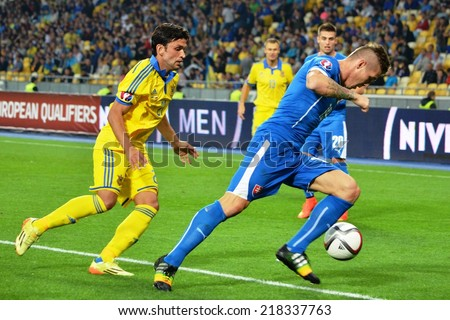 KIEV, UKRAINE - SEP 8: Football team Slovakia and Ukraine in the fight during the match Ukraine 0-1 Slovakia UEFA Euro 2016 qualifier match, 8 September 2014, Kiev, Ukraine