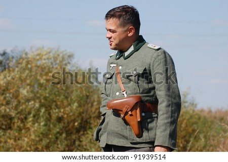 KIEV, UKRAINE -SEPT 18: A member of Red Star history club wears historical German uniform during historical reenactment of WWII, September 18, 2011 in Kiev, Ukraine
