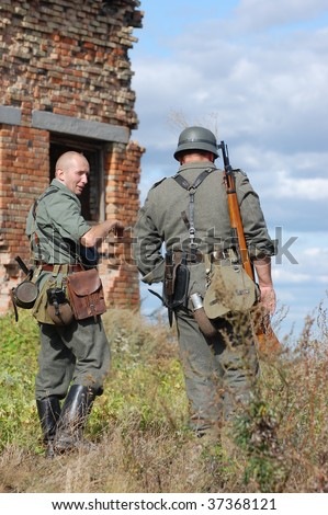 KIEV, UKRAINE - SEPT 19, : Members of a history club wear historical German uniforms as they participates in a WWII reenactment.Buttle for Kiev in 1943. September 19 , 2009 in Kiev, Ukraine