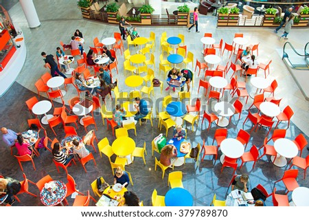 KIEV, UKRAINE - SEPT 22, 2015: People at Ocean Plaza shopping mall in Kiev. Ocean Plaza is the second largest shopping mall and entertainment complex of Kiev. - stock photo