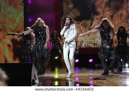 """KIEV, UKRAINE - SEPT. 23: Winner Eurovision singer Ruslana arrives at the opening , at the Opera Theatre 40th Film Festival """"Molodist"""" on September 23, 2010 in Kiev, Ukraine - stock photo"""