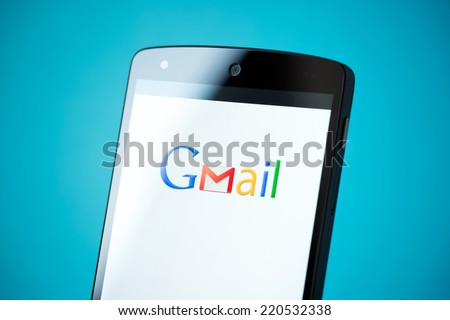 Kiev, Ukraine - September 24, 2014: Close-up shot of brand new Google Nexus 5, powered by Android 4.4 version with Gmail logotype on a screen. - stock photo