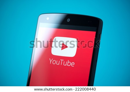 Kiev, Ukraine - September 24, 2014: Close-up shot of brand new Google Nexus 5, powered by Android 4.4 version, with YouTube logotype on a screen.  - stock photo
