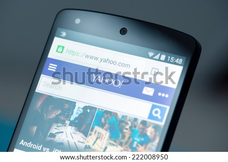 Kiev, Ukraine - September 12, 2014: Close-up shot of brand new Google Nexus 5, powered by Android 4.4 version, with Yahoo website news page on a screen. - stock photo