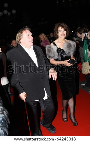 """KIEV, UKRAINE - SEPTEMBER   23:  Gerard Depardieu and Fanny Ardant arrive at the opening , at the Opera Theatre  40th  Film Festival """"Molodist"""" on September 23, 2010 in Kiev, Ukraine - stock photo"""