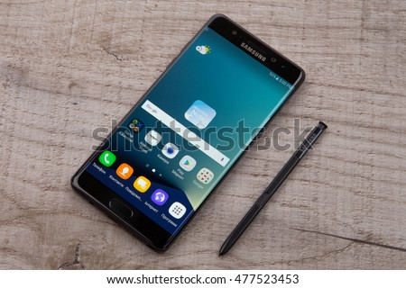 Kiev, Ukraine - September 3, 2016: Studio shot of a Samsung Galaxy Note 7 smartphone, with 12 mP Camera, Exynos 8890 Octa and 5.7 display, 2560   1440 resolution on wood.
