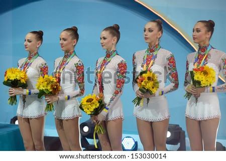 KIEV, UKRAINE - SEPTEMBER 1: Team Ukraine win bronze in the routing with clubs during the 32nd Rhythmic Gymnastics World Championships in Kiev, Ukraine on September 1, 2013 - stock photo