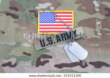 KIEV, UKRAINE - September 5, 2015. US ARMY branch tape with flag patch  and dog tag on camouflage uniform