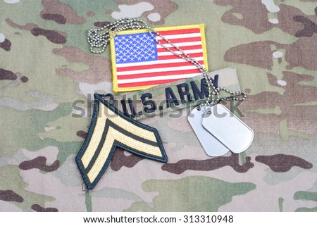 KIEV, UKRAINE - September 5, 2015. US ARMY Corporal rank patch, flag patch, with dog tag on camouflage uniform