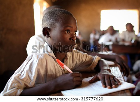 KIGOMA - TANZANIA - JULY 9, 2015: Unidentified student in primary school on July 9, 2015 in Kigoma, Tanzania. Tanzania has still an alarming drop-out rate of students in primary school - stock photo