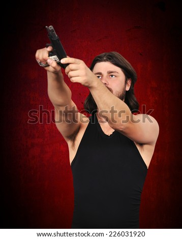 Killer reload gun on a red background - stock photo