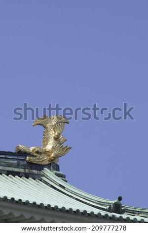 Killer whale pike and gold castle tower of Nagoya Castle - stock photo