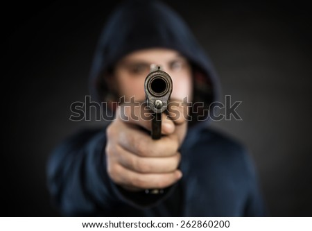 killer with gun  isolated on a black background - stock photo