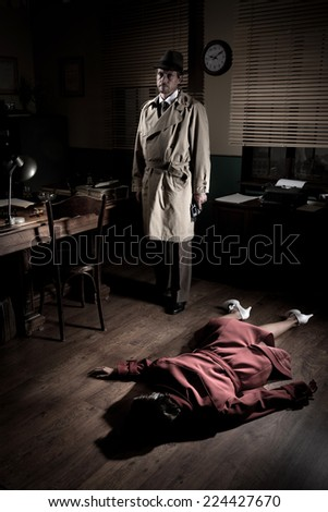 Killer with gun next to a dead woman body lying on the floor, film noir scene. - stock photo