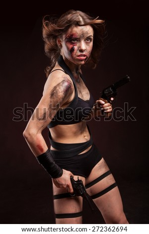 Killer woman with knife. Posing in studio.